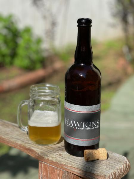 Hawkins Farmhouse Ales Relevance ale in glass next to bottle